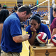 Ginger Lei Wright works with Coach Clint Barnes to get ready for Taylorsville High School's volleyball game against Jordan High School. (Tori La Rue/City Journals)