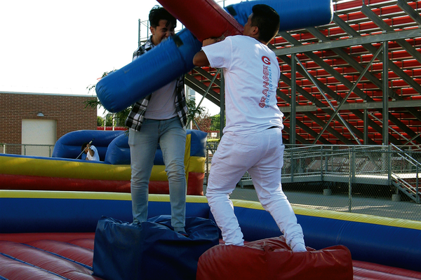 Students joust at the Granger Carnival on Sept. 7. Participants had to knock their opponent off the pedestal. (Travis Barton/City Journals)