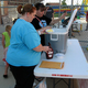Members of the Parent Teacher Student Association (PTSA) were on hand to serve ice cream during the Granger Carnival on Sept. 7. (Travis Barton/City Journals)