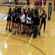 The Wolverines gather around second year head coach Rebecca Dees and get instruction. (Greg James/City Journals)