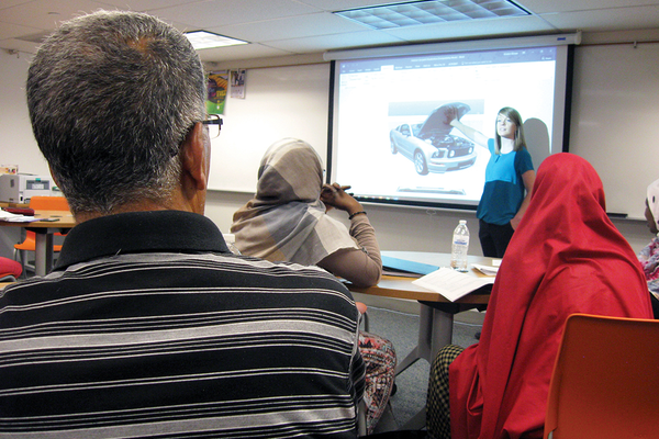 Refugees learn about vehicles during their English as a second language drivers education course at the Utah Refugee Education and Training Center. (Travis Barton/City Journals)