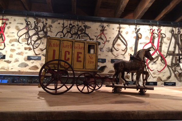 One of the many antique toy ice wagons on display.