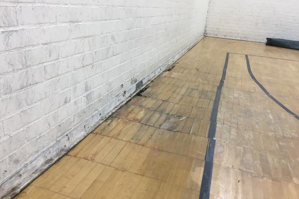 The basketball court floor in the small gym.