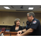 : Chief Lee Russo speaks with Donna Kelley of the Utah Prosecution Council in April at West Valley City Hall. (Travis Barton/City Journals)