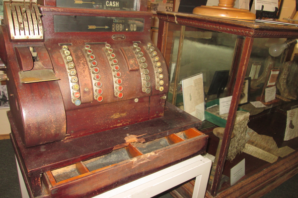 The wooden cash register and display case from Simon's Men's and Boy's Outfitter.