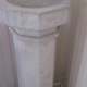 An early baptismal font stands in the entryway to the church.