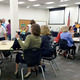 Community Engagement Coordinator Susan Edwards and Nancy Tingey, vice president of the Canyons School District Board of Education, lead parents in a mock school community council workshop. (Rubina Halwani/City Journals)