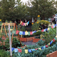 """The 2016 theme for the Growing Hope Project was """"Embrace Diversity."""" Connie Mason gifted the Tibetan monk prayer flags to promote compassion, peace, wisdom and strength. (Keila Mower/South Jordan Resident)"""