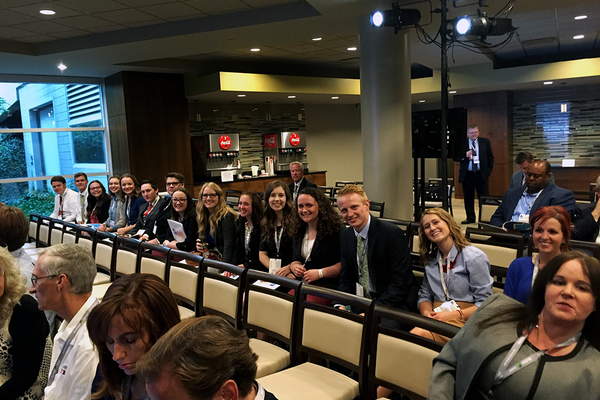 Officers from Herriman High School's career and technical student organizations sit and wait to hear speakers at the Utah Solutions Summit. (Julianna Wing/Herriman High School)