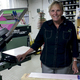 Jackie Lemesevski displays one of her screen printing machines at Underground Graphics on Walnut Street Staff photo by Samantha Sciarrotta
