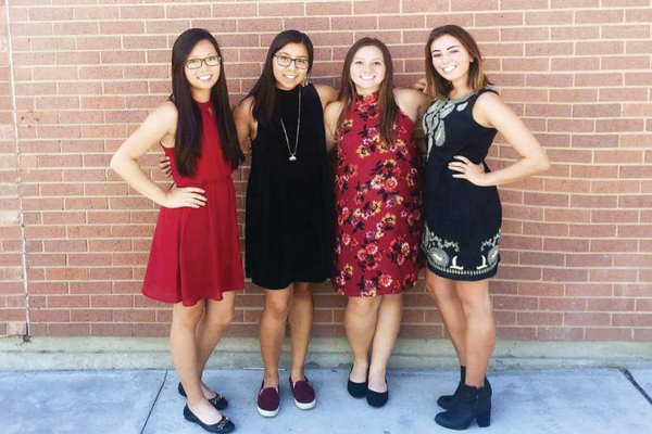 "Pictured left to right, seniors Soyoung Jeon, Yutzil Roman, Lacy Chun and Brianna Bernstein pose for a photo before an afternoon match. In keeping with tradition, the Huskies dress up on days they have home matches. ""We would dress up so that our fellow students knew there was home tennis match,"" said Bernstein. (Brianna Bernstein/Hillcrest Tennis Player)"