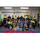 After spending the day teaching Liberty kindergartners about TRAX safety, Utah Transit Authority police and students smile for a group photo. (Julie Slama/City Journals)