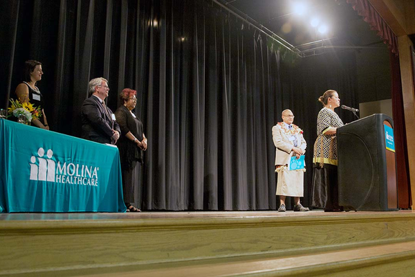 Molina Healthcare's 2016 Community Champion Siuea (Pete) Kupu (behind podium) was joined on stage by a member of the National Tongan American Society to accept his $1,000 grant awarded by Molina Healthcare. (Kristen Jacobsen/Kristen Jacobsen Photography)