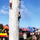Students climb a rock climbing wall during the STEMfest at Neil Armstrong Academy on Oct. 11. (Travis Barton/City Journals)