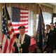 The opening of the luncheon featured a flag ceremony.