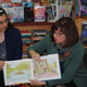 Marcella Harte and Nancy Sakaduski read their book to children during an event at the Hockessin Book Shelf