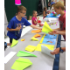 "Fourth-grader Logan Wilson learned how to make different kinds of paper airplanes and then established his business, ""Awesome Airplane Acts"" as part of South Jordan Elementary's Economics Fair. — Julie Slama"