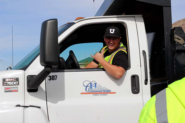 Operations Specialist Mitchell Ackley drives off to practice his snowplowing route in one of the city's newest trucks. (Cassie Goff/City Journals)