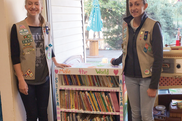 Ninth-graders Sierra Bieling and Alysa Gribben in troop 2406 helped supply the Autism and Behavioral Intervention Center in Draper with a bookshelf, books and funding. (Clara Gribben/Girl Scout volunteer)