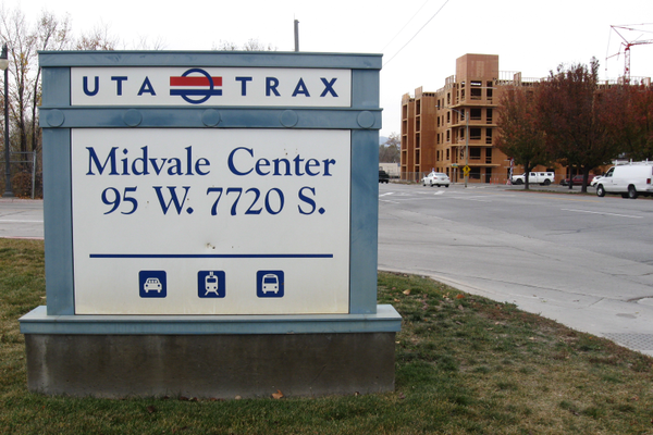 The Trax station at Midvale Center marks the transit oriented development area where mixed use and higher density residential use can be implemented such as the Station at Midvale Apartments being built. (Travis Barton/City Journals)