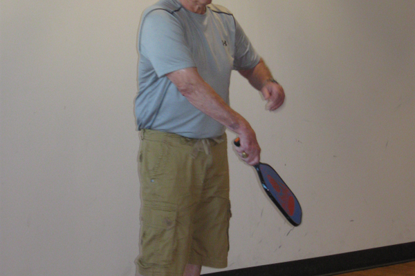 Roy Anthony serves as he plays pickleball at the Midvale Senior Center. Anthony is one of many seniors playing the sport each weekday at the center. (Travis Barton/City Journals)