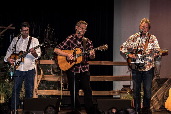 "Quint Randle, Jeff Hinton and Ron Saltmarsh of Joshua Creek play their guitars at a performance to uplift families. The group is probably best known for its song, ""Love You Son."" (Courtesy Joshua Creek)"