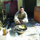 Sgt. Michael Terry makes lunch at a checkpoint in Iraq with bartered eggs and potatoes from an Iraqi vendor. (Michael Terry)