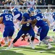Matt Degn, Bingham's quarterback, receives the ball at the championship game. (Pat McDonald)