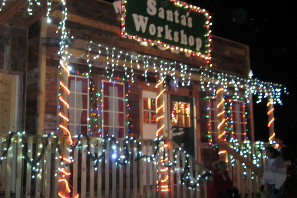The Trading Post in Bluffdale City Park is decked with lights and decorations in preparation for the city's Santa and the Lights tradition. The Santa and the Lights tradition gives local families an opportunity to visit with Santa and includes a tractor parade. (Bluffdale City Volunteers)