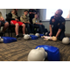 Capt. Jared Price of the West Jordan Fire Department teaches a class of Boy Scouts how to perform CPR on an infant on Nov 8. The department started offering merit badge classes as a service to the community in October. (Tori La Rue/City Journals)