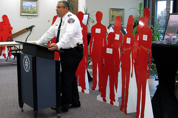 Police Chief Lee Russo speaks during the Shine a Light, Be a Light program at city hall on Tuesday, Oct. 25. (Travis Barton/City Journals)