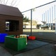 The music and movement area was created using used materials such as PVC pipes and buckets, all in an effort to create an outdoor classroom for the children's development. (Travis Barton/City Journals)
