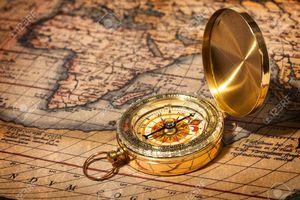 Medium 13992728 old vintage retro golden compass on ancient map stock photo