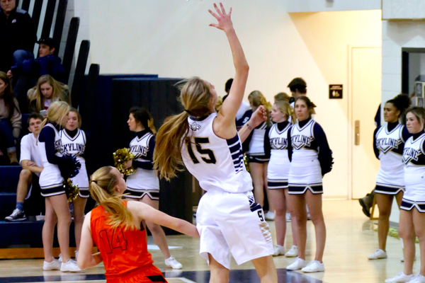 Senior Hannah Anderl goes for the layup against Murray on Jan. 6 at Skyline High School. The two-year captain leads the team in assists and steals. (jorgiabarryphoto)