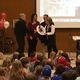"""Utah Clean Cities' Tammie Bostick Cooper presented Superintendent Jim Briscoe and board of education members with the """"Turn the Key, Be Idle Free"""" award. (Julie Slama/City Journals)"""