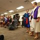 """The Genie, played Kimberly Stevenson, offers Aladdin, played by Austin Bigelow, all he could possible desire in SCERA's Acting Up Youth Theater performance of Disney's """"Aladdin"""" at the Sandy Library. (Keyra Kristoffersen/City Journals)"""