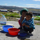 Children of Ecuador washing their hands before play. (Mary and Tyler McFarland)