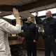 New Murray city police officers William Riding and Steven Jennings are sworn in by Jennifer Kennedy at the Dec. 13 city council meeting. (Mandy Ditto/City Journals)