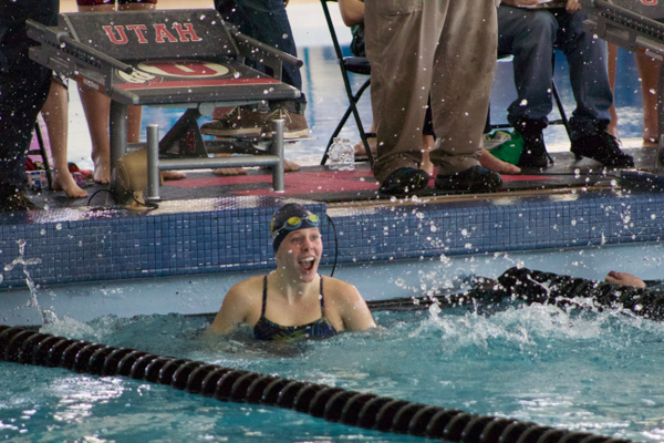 Junior Sarah Fillerup reacts after seeing her time in the 100-yard backstroke at the region meet. Fillerup went on to take second at the 4A state swim meet. (Travis Barton/City Journals)