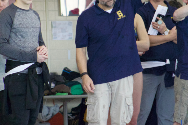 Head Coach Joe Pereira urges on his swimmers during their region meet. (Travis Barton/City Journals)