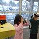 Logan Lee and Anuhea Kau enjoy the day of the tiger within David Selberg's virtual reality glasses. (Keyra Kristoffersen/City Journal)