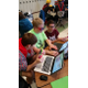 Two students from the Velocity Raptors robotics team at Oquirrh Hills Middle School help a student from Morgan School District problem-solve at a regional event. The OHMS team is known for its willingness to help other teams succeed, according to its coach, Todd Monson. (Todd Monson)