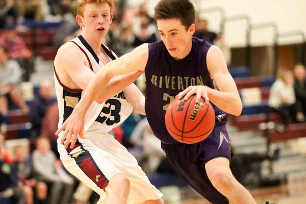 Riverton junior Ryen Edwards has averaged seven points a game for the Silverwolves. He is guarded by Herriman's leading scorer Ryan Mccann (Dave Sanderson/dsandersonpics.com)