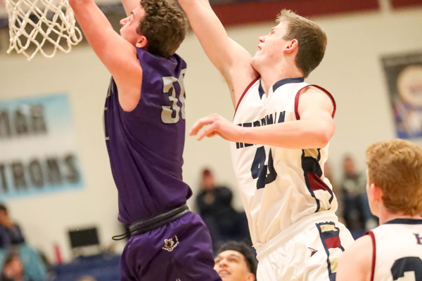 Herriman sophomore Blake Freeland attempts to block a possible dunk. The sophomore is averaging five points a game for the Mustangs. (Dave Sanderson/dsandersonpics.com)