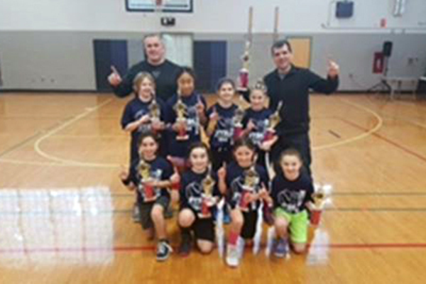 The Girls 3rd-4th grade division was won by the Bellingham Police team, coached by Jon Walden. It was a close game and the First Realty Management team put up a great fight. The Bellingham Police team walked away with a 19-10 victory that was hard fought.