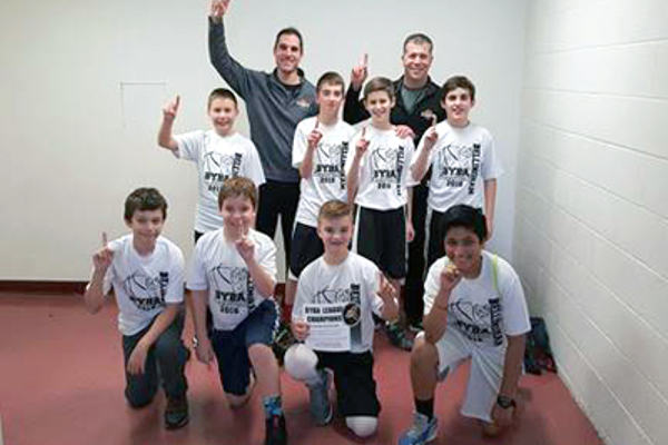 The Boys 5th- and 6th-Grade Division had a great season with 9 teams. The final matched Flooring Design and Cornerstone Family Chiropractic.  Cornerstone Family Chiropractic got out to an early lead, but Flooring Design battled back in the second half in a very competitive game.  In the end, Cornerstone Family Chiropractic, coached by Matt Hanson, held on to win the championship 44-29.