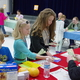 Elk Meadows third-graders learn about managing money during the school's annual Kids Marketplace where students assume careers and need to pay for housing, transportation, food and other monthly expenses. (Julie Slama/City Journals)