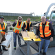 City Councilman Ernest Burgess (right) and others fold cardboard for recycling. (Taylorsville City)