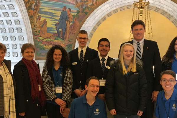 State Representative Jim Dunnigan (tallest) is surrounded by members of the Taylorsville Youth Council. City council members Dama Barbour and Kristie Overson (left) joined them for a trip to Utah's Capitol Hill. (Taylorsville City)