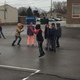 Students jump rope during recess at Redwood Elementary. Students wearing purple shirts are the junior coaches. (Josh Rose/Playworks)